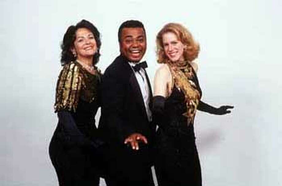 Livia Genise, Timothy Matthews and Beth Wilmurt in ``Christmas Cavalcade,'' a revue of holiday songs at Marines Memorial Theatre.