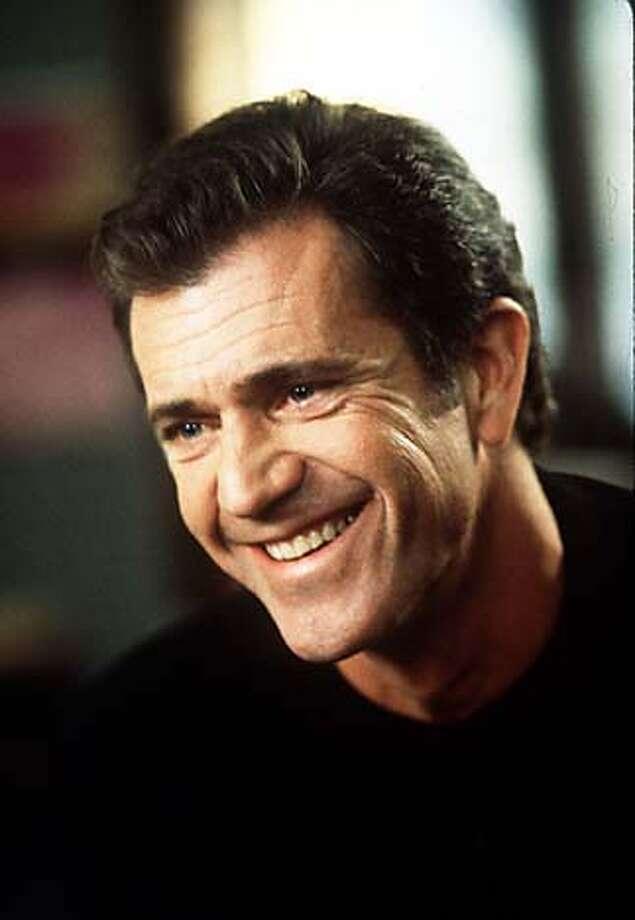 WHAT15C-C-14DEC00-DD-HO --- Mel Gibson in What Women Want  (HANDOUT PHOTO) CAT standard mug crop Photo: HANDOUT