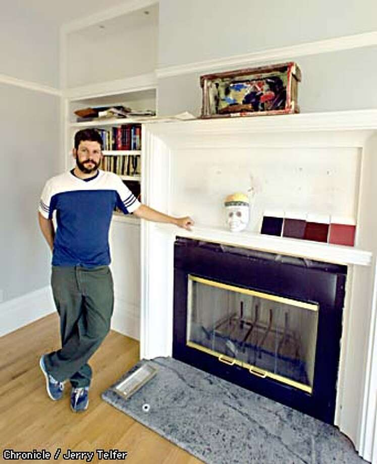 The onetime Oakland home of borax king Francis Marion Smith has been renovated by Jason Porter over a period of three years. The mantle of this fireplace will have a large mirror when finished.  817 East 24th Street - Oakland, CA  CHRONICLE STAFF PHOTO BY JERRY TELFER Photo: JERRY TELFER