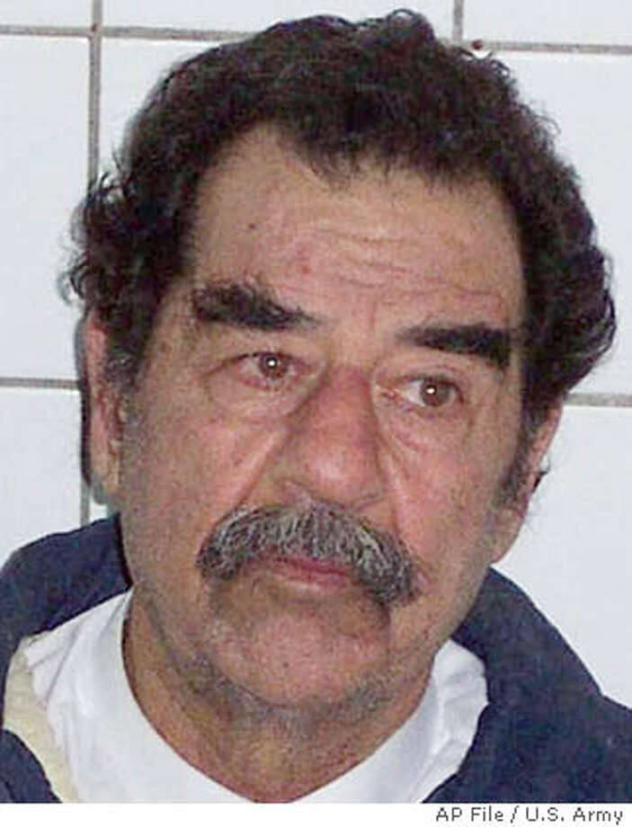 In this image released by the U.S. Army on Sunday Dec. 14, 2003 former Iraqi President Saddam Hussein is shown in custody after he was arrested near his Tikrit home Saturday night.(AP Photo/HO)