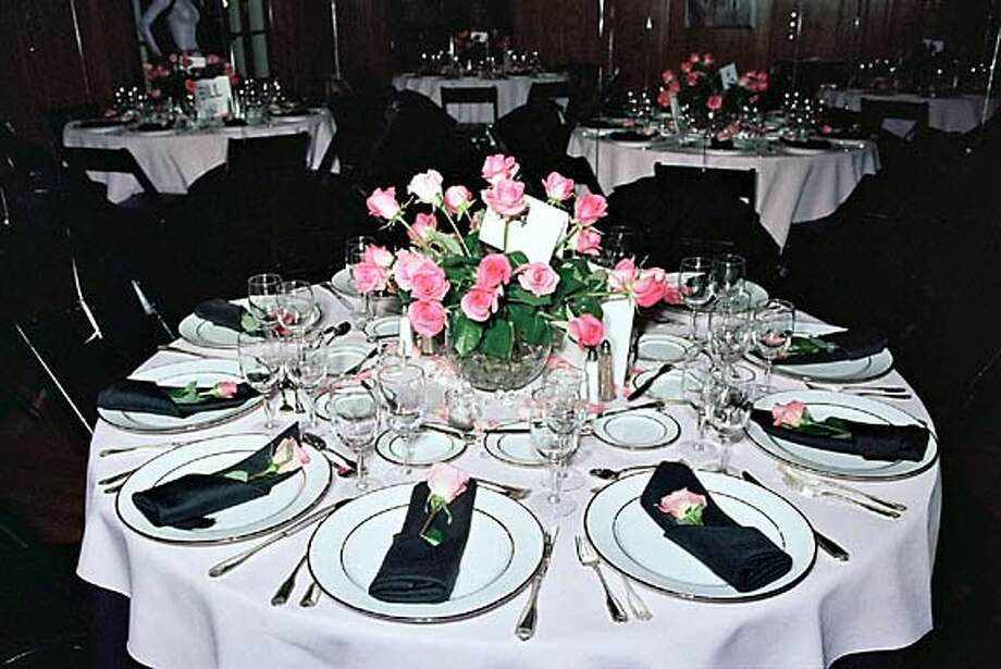 Bright Pink roses and black napkins create a retro color scheme for Villa Montalvo's Valentine Ball on Feb. 6.  Special to the Chronicle Thomas J. Gibbons