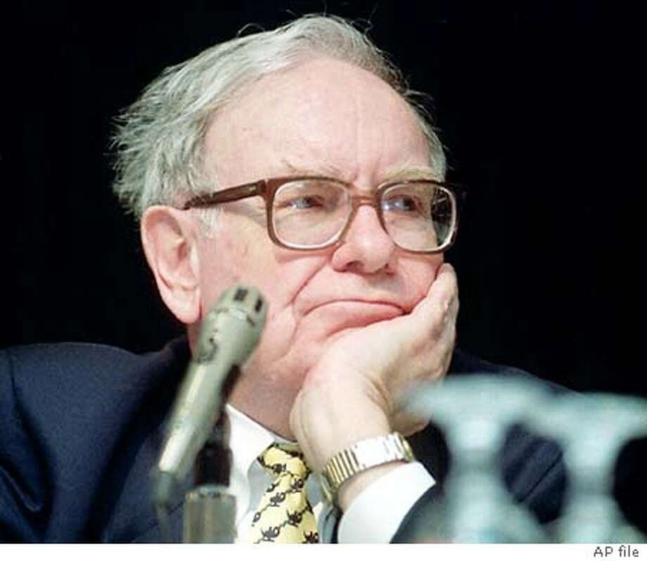 Bershire Hathaway's Warren Buffett listens to questions during his Sunday May 2, 1999 press conference in Omaha, Neb, before Berkshire Hathaway's shareholder's meeting on Monday. (AP Photo/Dave Weaver) Photo: DAVE WEAVER