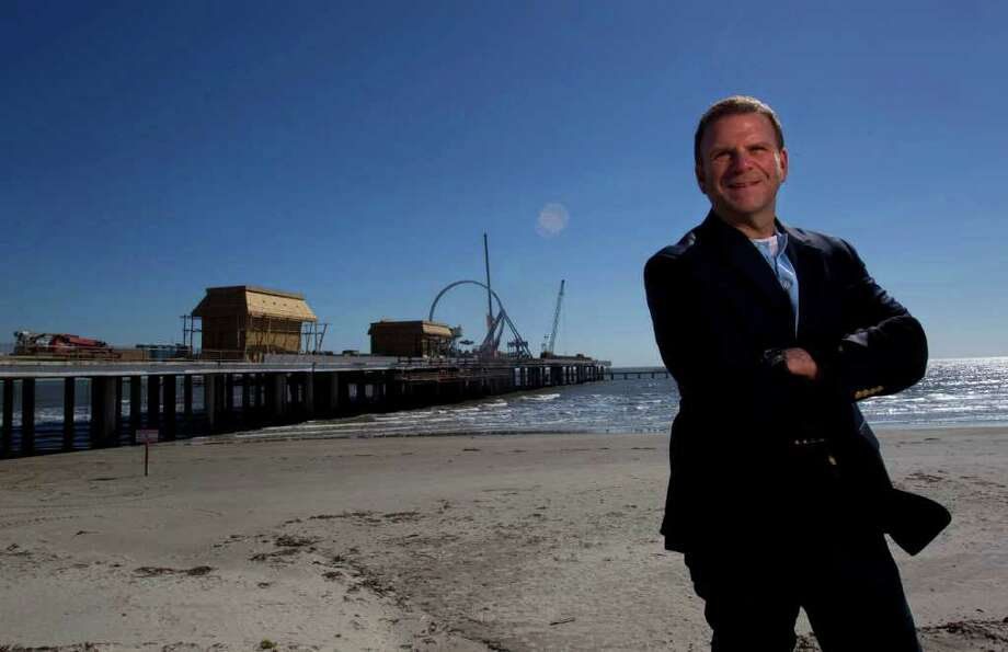 Portrait of entrepreneur, developer and restauranteur Tilman Fertitta next to his latest venture Pleasure Pier along Seawall and 25th St. at the former location of the Flagship Hotel Saturday, Jan. 28, 2012, in Galveston.  The pier will be an entertainment destination with carnival rides, games and food including a Bubba Gump Shrimp Co. restaurant. ( Johnny Hanson / Houston Chronicle ) Photo: Johnny Hanson / © 2012  Houston Chronicle