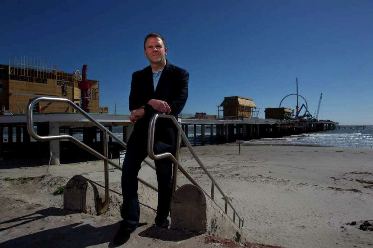 Portrait of entrepreneur, developer and restauranteur Tilman Fertitta next to his latest venture Pleasure Pier along Seawall and 25th St. at the former location of the Flagship Hotel Saturday, Jan. 28, 2012, in Galveston. The pier will be an entertainment destination with carnival rides, games and food including a Bubba Gump Shrimp Co. restaurant. ( Johnny Hanson / Houston Chronicle )