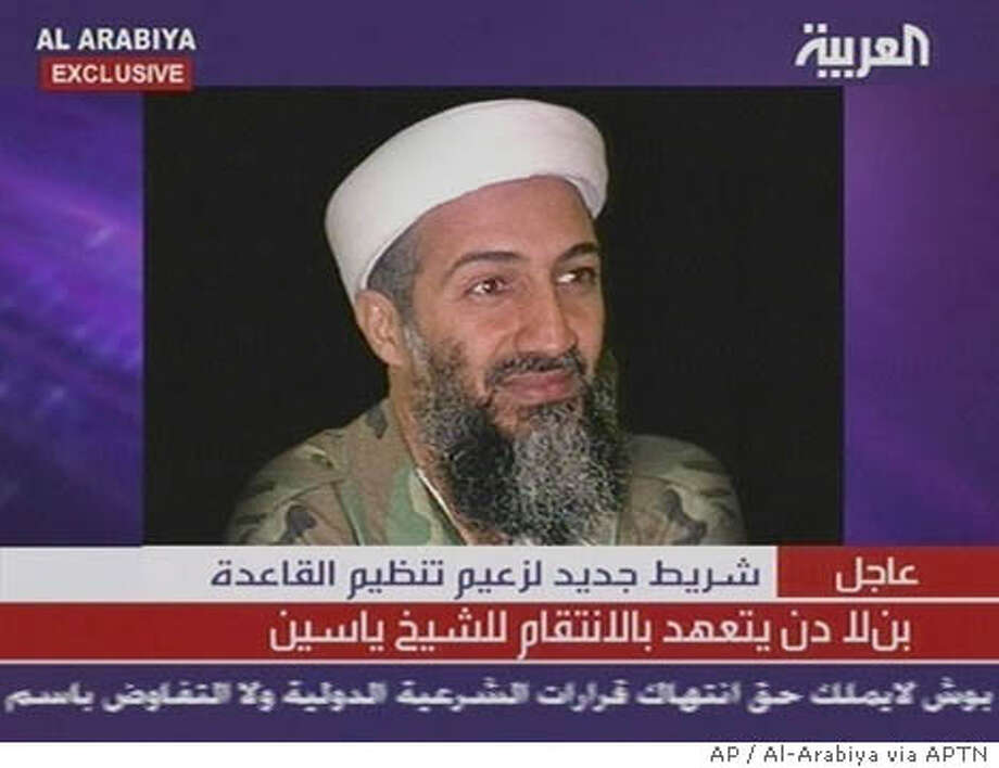 "An undated image of al-Qaida leader Osama bin Laden is shown on screen as Arab satellite network al-Arabiya broadcasts a new audio recording of a man identifiying himself as bin Laden, in this image made from television Thursday, April 15, 2004. The message offered a ""truce"" with European countries that did not attack Muslims and vowed revenge for Israel's killing of Sheik Ahmed Yassin, leader of the Palestinian militant group Hamas. (AP Photo/Al-Arabiya via APTN) ** TV OUT **"