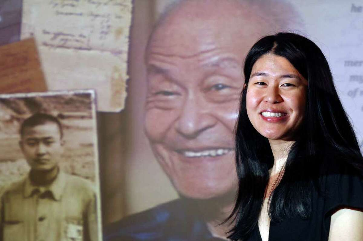 """Portrait of Theresa Loong with an image of her father Paul Loong from her film documentary film """"Every Day Is a Holiday"""" Saturday Jan. 28, 2012 during the 25th annual Asian Festival held at The Institute of Texan Cultures."""