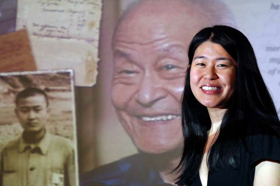 "Portrait of Theresa Loong with an image of her father Paul Loong from her film documentary film ""Every Day Is a Holiday"" Saturday Jan. 28, 2012 during the 25th annual Asian Festival held at The Institute of Texan Cultures. Photo: EDWARD A. ORNELAS, San Antonio Express-News / © SAN ANTONOI EXPRESS-NEWS (NFS)"
