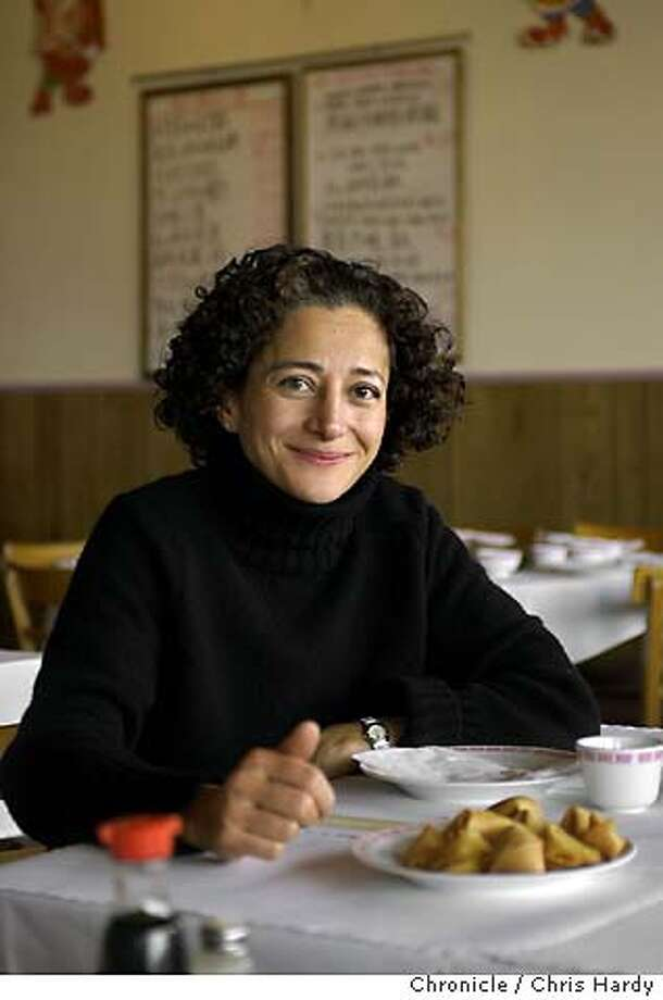 Chef Donia Bijan, chef a L'Amie Donia in Palo Alto, eating at Silver House restaurant  Event on 2/5/04 in San Francisco. Chris Hardy / The Chronicle MANDATORY CREDIT FOR PHOTOG AND SF CHRONICLE/ -MAGS OUT Photo: Chris Hardy