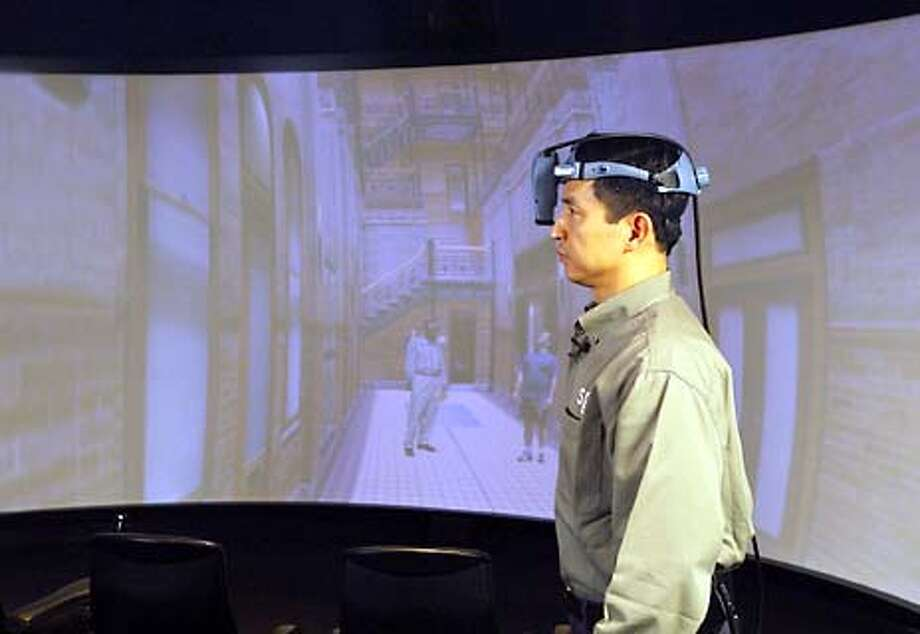 Silicon Graphics CTO Eng Lim Goh wears a retinal scanner that allows a user to view 3-D images in the Mountain View firm's Visual Area Network technology.  PHOTO COURTESY OF SGI Photo: HANDOUT