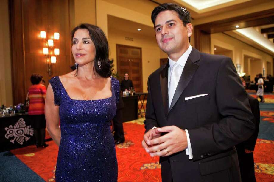 Raul Lomeili-Azoubel (right), 2012 chairman of the San Antonio Hispanic Chamber of Commerce, visits with host and former Los Angeles TV news anchor Giselle Fernandez in the foyer outside of the Grand Oaks Ballroom at the JW Marriott Hill Country Resort and Spa prior to the 83rd annual San Antonio Hispanic Chamber of Commerce gala  on Jan. 28, 2012.  Photo by Marvin Pfeiffer / San Antonio Express-News Photo: Marvin Pfeiffer/Express-News