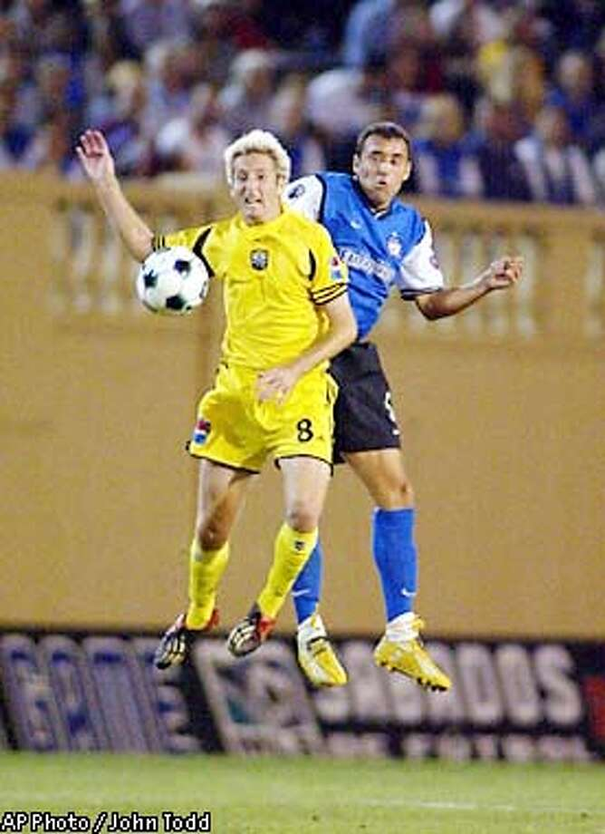 Columbus Crew's Duncan Oughton (8) and San Jose Earthquakes' Ramiro Corrales, right, battle for the ball in the first half at Spartan Stadium, in San Jose, Calif., Wednesday, Sept. 25, 2002. (AP Photo/John Todd) Photo: JOHN TODD