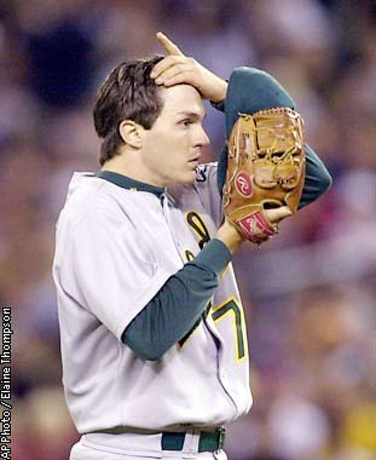 Oakland Athletics starter Barry Zito reacts after throwing going to ball three in the count to Seattle Mariners' Carlos Guillen with the bases-loaded during the sixth inning Tuesday, Sept. 24, 2002, in Seattle. Zito walked Guillen forcing in a run. (AP Photo/Elaine Thompson) Photo: ELAINE THOMPSON