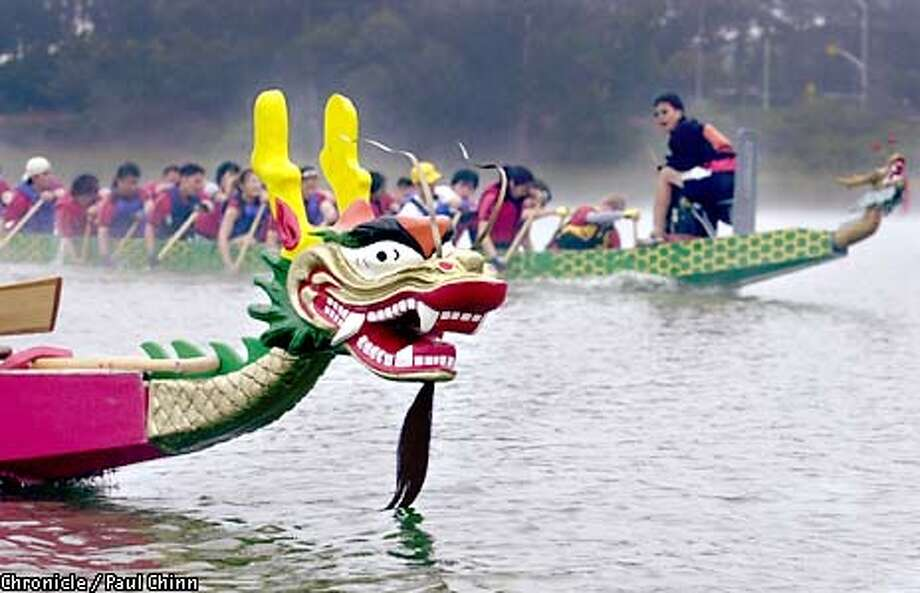 Menacing dragon heads are attached to the bow of the race boats. The Dragon Warriors dragon boat racing team train at the north end of Lake Merced.  PAUL CHINN/S.F. CHRONICLE Photo: PAUL CHINN