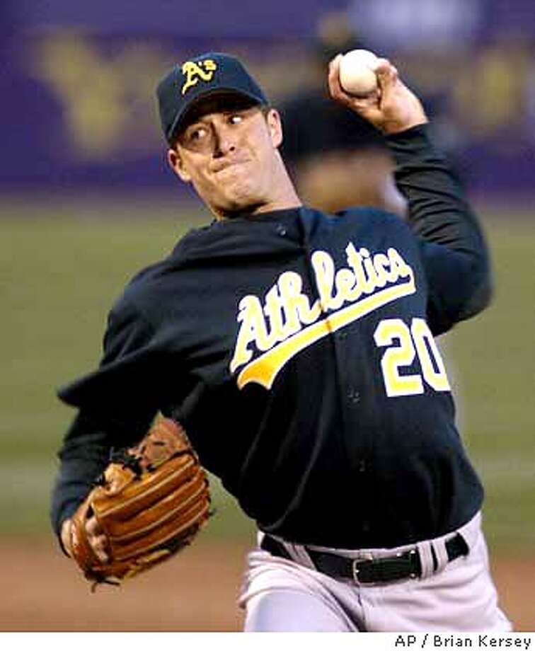 Oakland Athletics' starting pitcher Mark Mulder delivers during the first inning against the Chicago White Sox on Wednesday, April 30, 2003, in Chicago. Mulder pitched a complete game giving up just 4 hits in the Athletics' 4-1 win. (AP Photo/Brian Kersey) CAT Photo: BRIAN KERSEY
