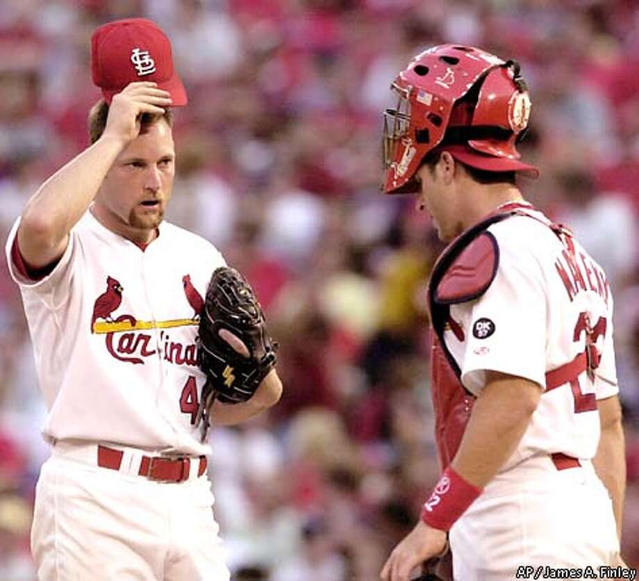 St. Louis Cardinals starter Jason Simontacchi, left, and catcher Mike Matheny meet on the mound during the sixth inning against the San Francisco Giants in St. Louis, Wednesday, July 17, 2002. (AP Photo/James A. Finley) Photo: JAMES A. FINLEY