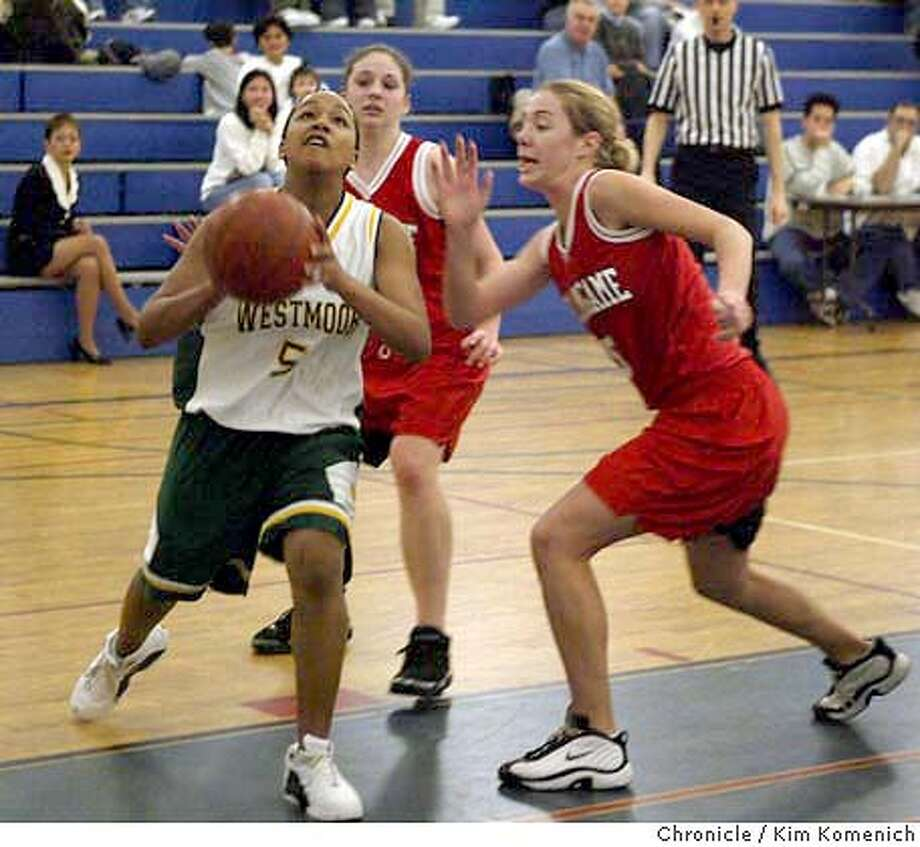 Westmoor's Brittany Reed (5) puts one up against Mariana Pappageorge (32), behind Reed, and Allison Smith (5) right. Westmoor girls beat Burlingame in semifinals of the Peninsula Athletic League Championships at South San Francisco High School.  Photo by Kim Komenich in South San Francisco. Photo: Kim Komenich