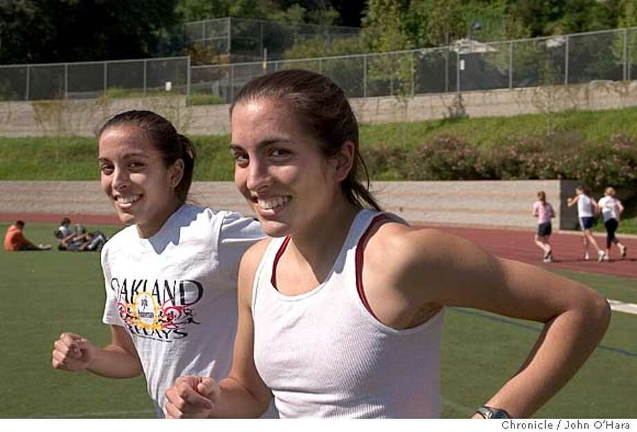 Piedmont High School, 800 Magnolia, Piedmont,CA  Whittier Field.  The Sparks twins, Naomi (t shirt with sleeves) and Jehan , no sleeves) who is 19 minutes older than her sister. They finished 1-2 in th BSAL meet and each made the NCS meet. Photo: John O'Hara