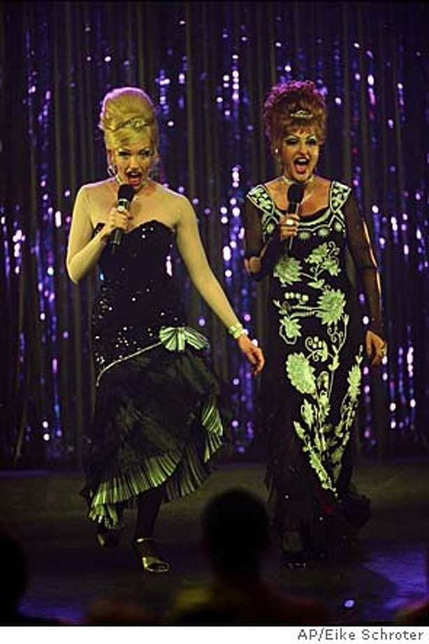 "Nightclub singers Connie (Nia Vardalos, right) and Carla (Toni Collette) become the toast of the L.A. cabaret scene, performing as drag queens, in the new comedy ""Connie and Carla."" (AP Photo/Eike Schroter) Toni Collette (left) and Nia Vardalos witness a mob hit, go on the lam and hide out in Los Angeles, where they play drag queens and become the toast of the gay cabaret scene. Photo: EIKE SCHROTER"