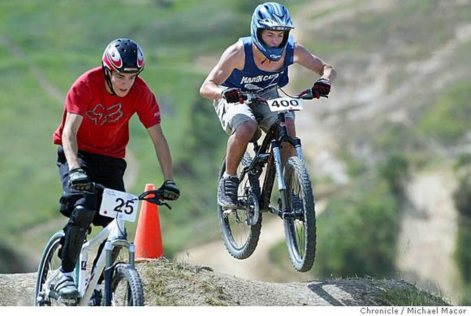 #400- Mike Ravizza goes up against #25- Mark Zorich in the first heat. The Mill Valley Extreme Bike Team, lead by Mark Green competes in various bike events throughout the Bay Area. Green along with two team members compete in the Sandhill Dual Slalom races today. event on 4/3/04 in Brentwood Michael Macor / San Francisco Chronicle Photo: Michael Macor