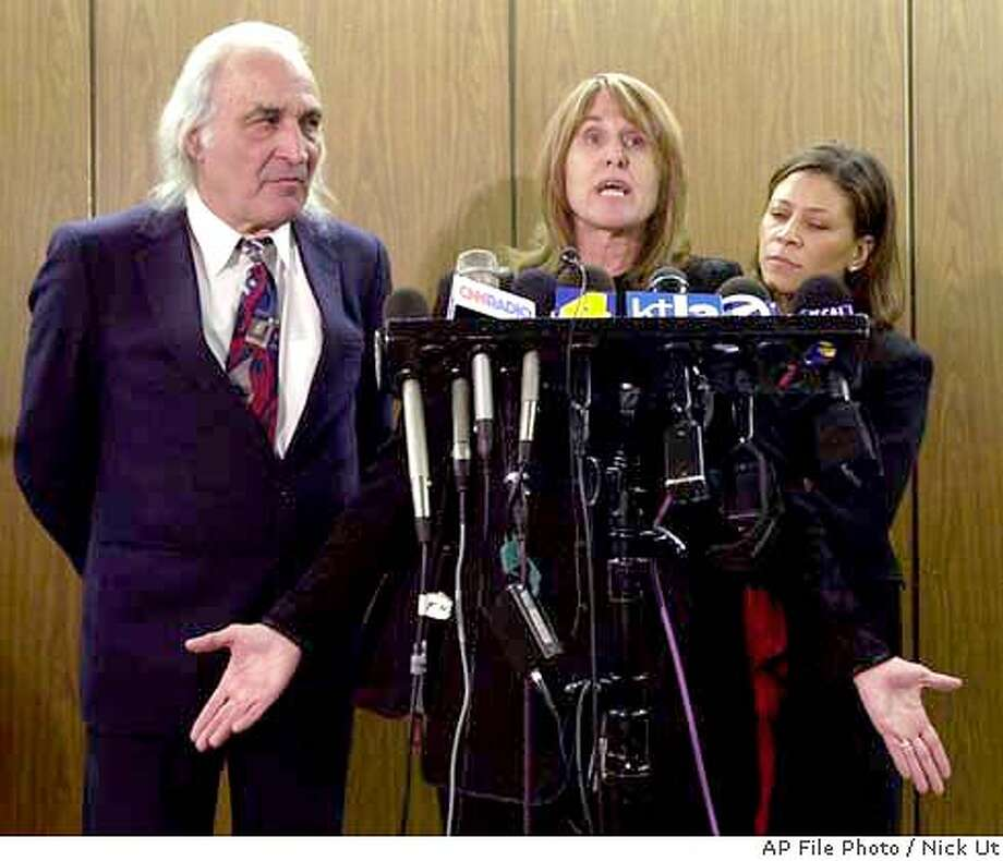Sara Jane Olson , center, gestures as she speaks at a news conference following a hearing in Superior Court in Los Angeles Friday, Feb. 23, 2001, while her attorneys, Tony Serra, left, and Shawn Chapman, look on. The former SLA fugitive lashed out at prosecutors saying they have politicized her case and are trying to destroy an innocent woman. (AP Photo/Nick Ut) Photo: NICK UT