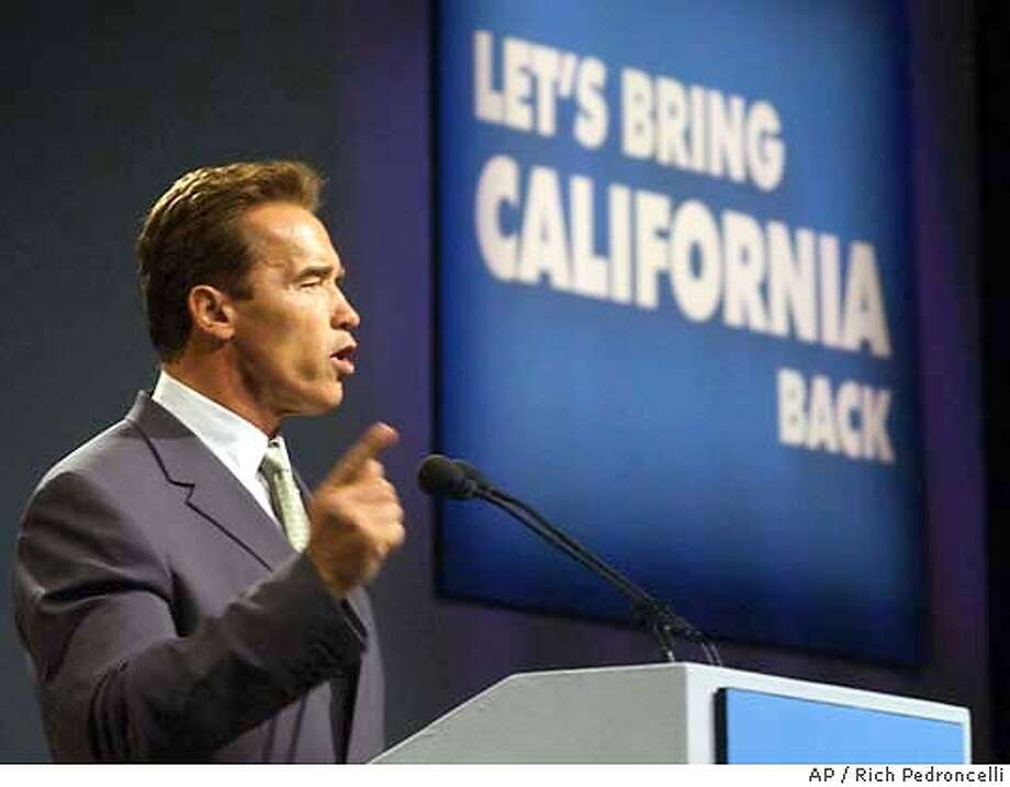 Republican gubernatorial candidate Arnold Schwarzenegger, presents a 10-point plan he said he would implement during his first 100 days as governor while speaking in Sacramento, Calif., Wednesday, Oct. 1, 2003. While during his first 100 days in office Schwarzenegger did repeal the tripling of the state car tax as well as legislation allowing undocumented immigrants to get a drivers license, much of the Governor's legislative agenda remains mired in the Legilsature. Even his attempts at streamlining the bureaucracy and reforms in education appear to be months if not years away from passage.(AP Photo/Rich Pedroncelli, File) OCT. 1, 2004 FILE PHOTO Photo: RICH PEDRONCELLI