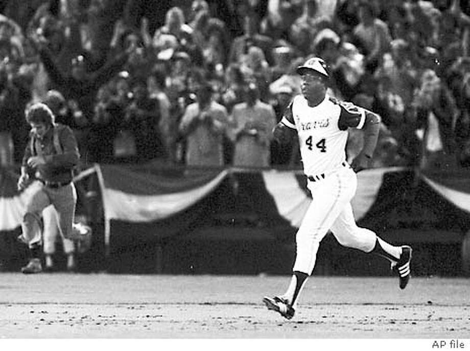 "FILE--Atlanta Braves slugger Henry Aaron rounds the bases after hitting his 715th career home run against the Los Angles Dodgers on April 9, 1974, in Atlanta. The way Aaron sees it, America would have preferred someone else to break Babe Ruth's home run record. Someone white. ""No question about that,"" Aaron said, chuckling a little. ""Back then, if they had a choice, they would have preferred Mickey Mantle. Or Stan Musial. Or Ted Williams. If it had to be someone black, I think they would have preferred Willie Mays. "" (AP Photo/file)"