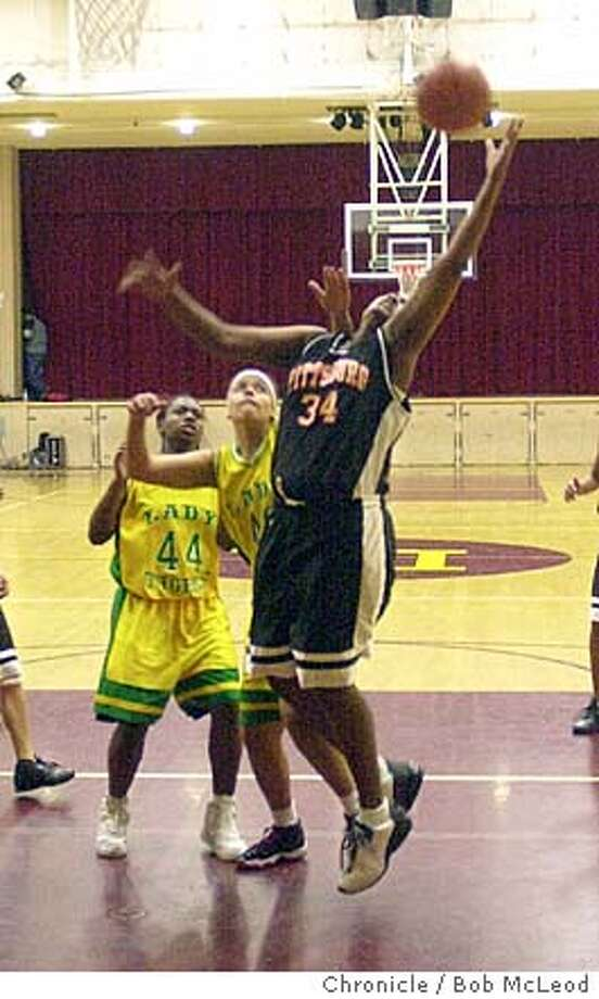 CCSOPHS27-C-20DEC02-CF-BM  NECOLIA SIMMONS, OF PITTSBURG hi (right, #34) goes up for a basket in a gave against Las Lomas.  chronicle photo by bob mcleod