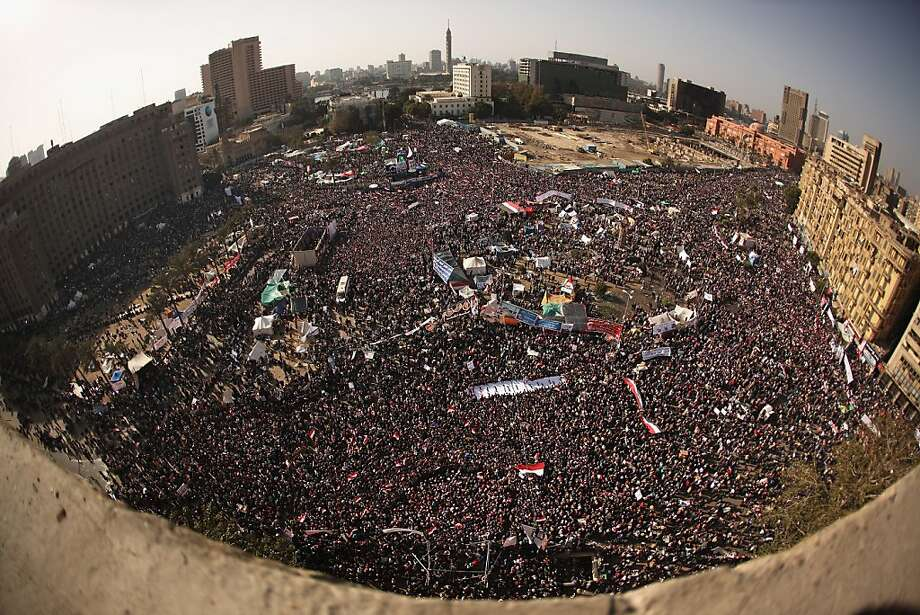 CAIRO, EGYPT - JANUARY 25:  Egyptians gather in their thousands in Tahrir Square to mark the one year anniversary of the revolution on January 25, 2012 in Cairo Egypt. Tens of thousands have gathered in the square on the first anniversary of the Arab uprising which toppled President Hosni Mubarak..  (Photo by Jeff J Mitchell/Getty Images) Photo: Jeff J Mitchell, Getty Images