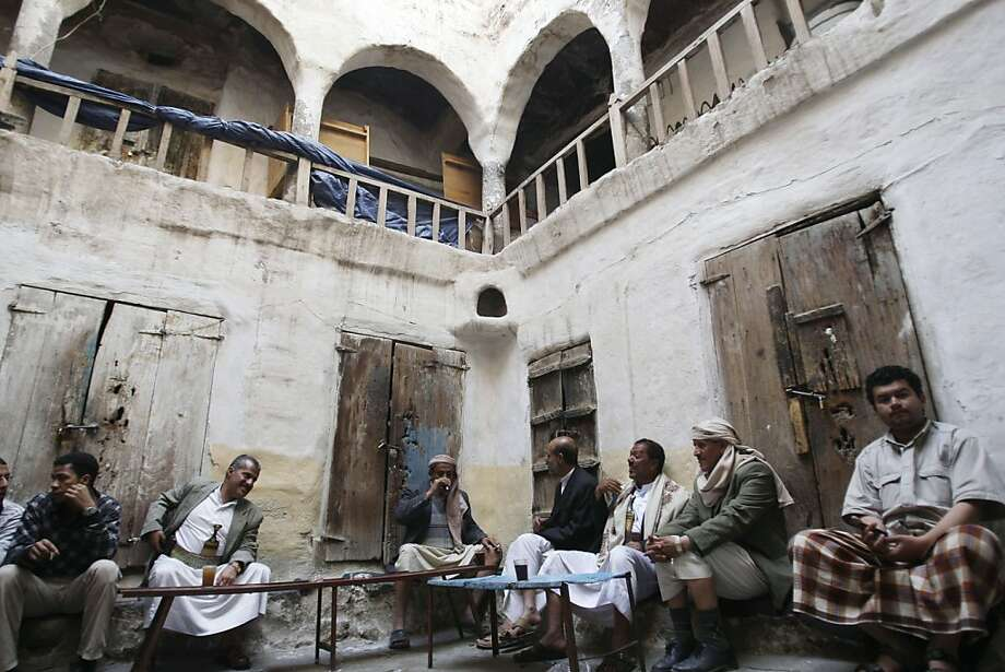 Yemenis chat as they sit in a traditional cafe in the old city of Sanaa, Yemen, Saturday, Jan. 28, 2012. Yemeni President Ali Abdullah Saleh headed to the United States on Saturday for medical treatment, his spokesman said, the latest stage in an effort to distance him from his country's policies to help ease a transition from his rule. (AP Photo/Hani Mohammed) Photo: Hani Mohammed, Associated Press