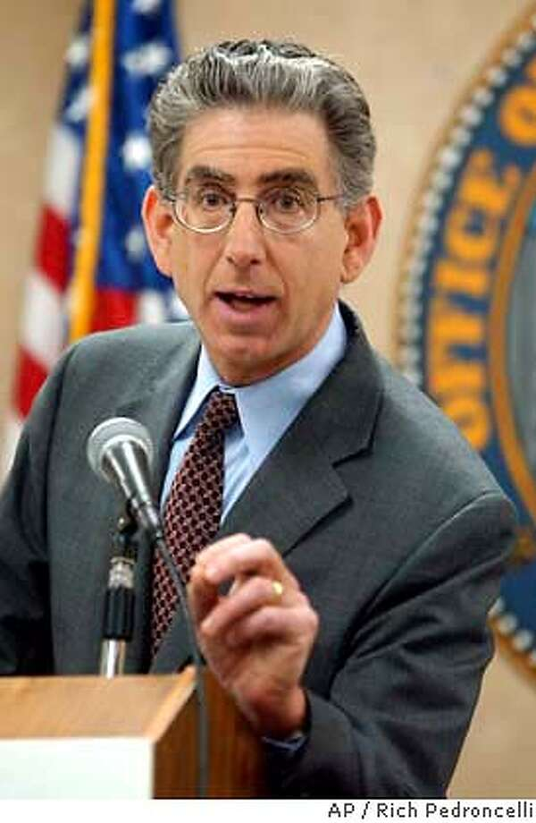 Treasuer Phil Angelides gestures as he discusses his backup plan to keep the state solvent if voters reject a $15 billion bond measure, during a news conference held in Sacramento, Calif., Thursday, Feb. 19, 2004. Worried that voters might turn down Gov. Arnold Schwarzenegger's Proposition 57 on the March ballot, Angelides unveiled his contingency plan that would raise income taxes on the highest-earning Californians and take out short-term loans from wall street investors.(AP Photo/Rich Pedroncelli) Treasurer Phil Angelides says a backup plan is needed if a $15 billion bond measure fails. Photo: RICH PEDRONCELLI