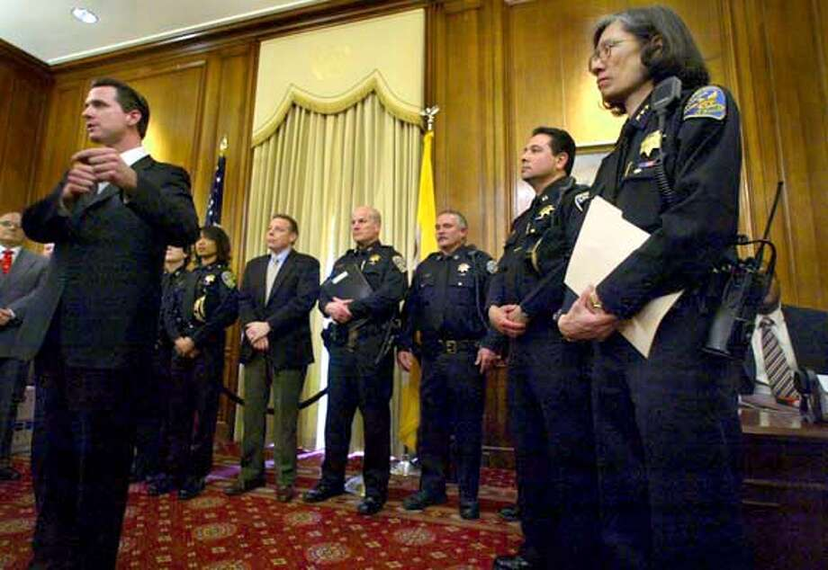 A69C1350.JPG  San Francisco Mayor Gavin Newsom talks with the media at a press conference with Acting Police Chief Heather Fong as she introduces her new command staff. Press conference is in the mayor's office. fong is on the far right. The others are her new command staff. Event on 2/19/04 in San Francisco. LIZ MANGELSDORF / San Francisco Chronicle MANDATORY CREDIT FOR PHOTOG AND SF CHRONICLE/ -MAGS OUT Photo: LIZ MANGELSDORF