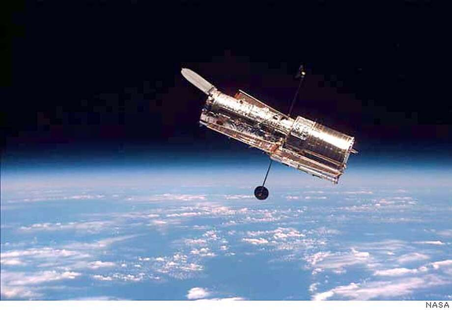 **FILE** The Hubble Space Telescope is shown following its release from the space shuttle Discovery in this Feb. 19, 1997 file photo. The Hubble Telescope will be allowed to degrade and eventually become useless, as NASA changes focus to President Bush's plans to send humans to the moon, Mars and beyond, officials said Friday, Jan. 16, 2004. (AP Photo/NASA, File) The Hubble Space Telescope is shown following its release from the space shuttle Discovery in this Feb. 19, 1997, file photo. Hubble Space Telescope observations of exploding stars, or supernovas, were called an invaluable tool by researchers. Metro#MainNews#Chronicle#1/17/2004#ALL#5star##0421572145 The Hubble Space Telescope is seen above Earth after its release from the shuttle Discovery in 1997. Photo: NASA