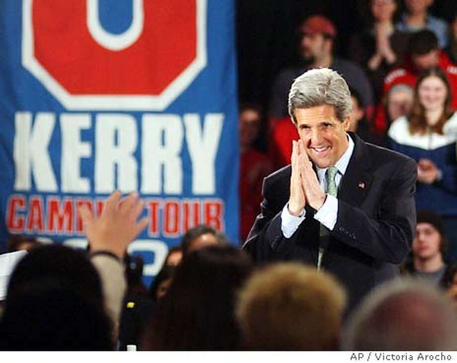 Democratic presidential candidate Sen. John Kerry, D-Mass., greets a crowd during a rally on the campus of the University of Rhode Island, in Providence, R.I., Tuesday, April 13, 2004. (AP Photo/Victoria Arocho) Photo: VICTORIA AROCHO