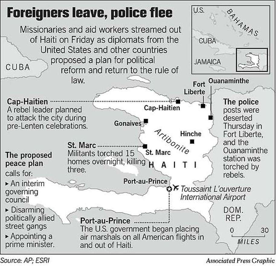 Foreigners Leave, Police Flee. Associated Press Graphic Photo: Chronicle Graphic