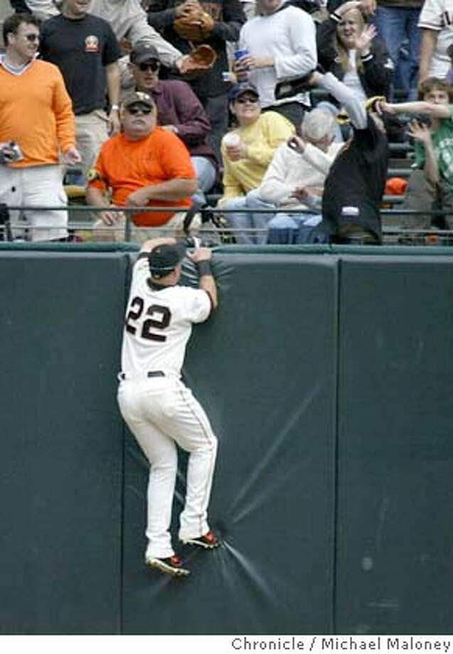 Giants Dustan Mohr can only watche as fans catch Brewer's Geoff Jenkins' homerun in the 2nd inning.  Giants vs Brewers at SBC Park. Brewers won 3-0.  Photo by Michael Maloney / CHRONICLE Photo: Michael Maloney
