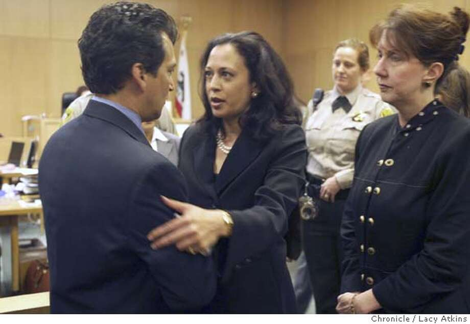 SF District Attorney Kamala Harris stops to talk with an unidentified family member (HE WOULD NOT GIVE NAME) of SF officer Isaac Espinoza at the arraignment of suspect David Hill, Wed. 14, 2004, in San Francisco.  Arraignment of David Hill in shooting of SF police officer Isaac Espinoza, AT THE HALL OF JUSTICE, WED. APRIL 14,2004, IN SAN FRANCISCO  LACY ATKINS / The Chronicle Photo: LACY ATKINS