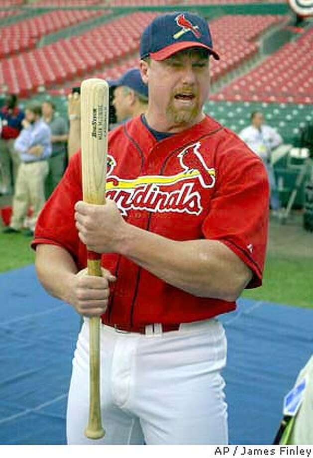 St. Louis Cardinals' Mark McGwire clutches a bat during warmups before Game 2 of the National League Championship Series against the New York Mets at Busch Stadium in St. Louis Thursday, Oct. 12, 2000. (AP Photo/James Finley) DIGITAL IMAGE Photo: JAMES. A. FINLEY