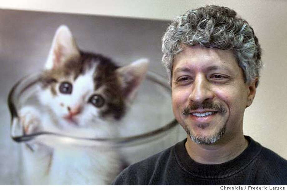 ; CEO Lou Hawthorne, a Marin entrepreneur of Genetic Savings and Clone of Sausalito is now offering to clone people's cats for $50,000 each. It's already been storing tissue samples of cats and dogs for a fee; now it says it's ready to go commercial with the cloning. Four pet owners have signed up; two more slots are open. The first cloned pets should be ready by November. The company was behind the first sucessful cloning of a cat, CC (Copy Cat), now two years old (in photo behind subject), who is healthy and living in Texas with one of the scientists who cloned her. City:� 4/5/04, in Sausalito, CA. Frederic Larson/The Chronicle; Photo: Frederic Larson