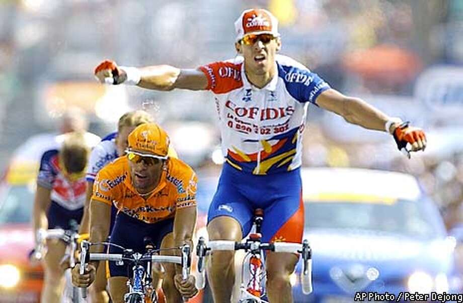David Millar of Britain reacts as he wins the 13th stage of the Tour de France cycling race between Lavelanet and Beziers, southwestern France, Saturday, July 20, 2002, ahead of David Extebarria of Spain, left, Michael Boogerd of the Netherlands, behind, and Laurent Brochard of France, background left. (AP Photo/Peter Dejong) Photo: PETER DEJONG