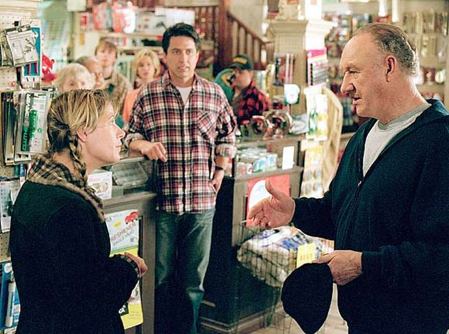 MOOSEPORT20  Ex U.S. President Cole (Gene Hackman, right) sparks to veterinarian Sally (Maura Tierney), much to the consternation of Sally�s boyfriend, Handy (Ray Romano). Former President Cole (Gene Hackman, right) takes an interest in Sally (Maura Tierney) while running for mayor against her boyfriend, Handy (Ray Romano), in &quo;Welcome to Mooseport.&quo;