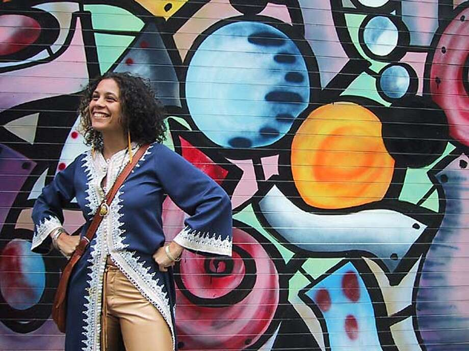 Urban view: Raquel Cepeda, who spent part of her childhood in the Bay Area, is the editor of OneWorld magazine, which covers hip-hop and urban culture. Photo courtesy of Sarah Hall Productions
