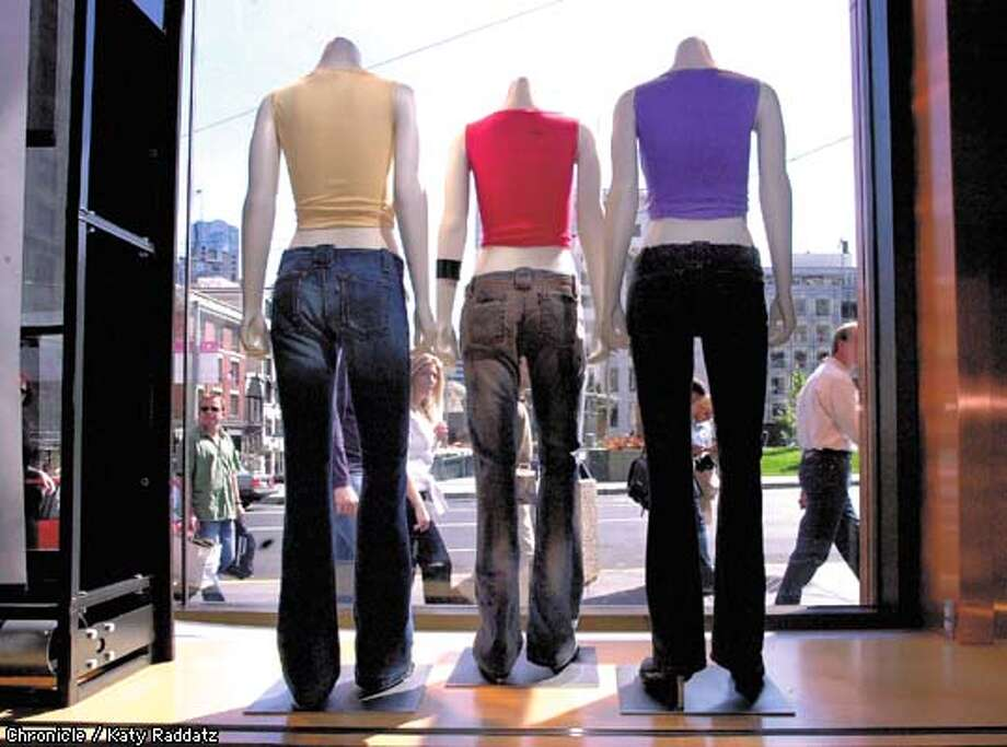 "PHOTO BY KATY RADDATZ--THE CHRONICLE  Low-waisted jeans helped Levi boost sales during the most recent quarter. We see hip-hugging styles for women and men all over the big Levi's store at Union Square. SHOWN: Mannequins in the front window wear ""Too Superlow"" jeans. Photo: KATY RADDATZ"
