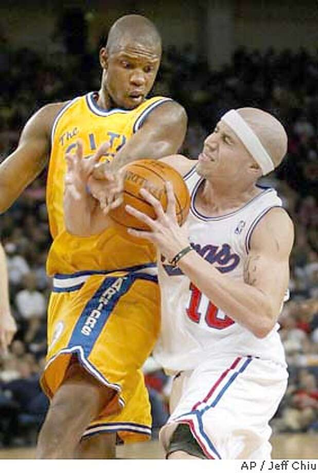 Sacramento Kings guard Mike Bibby, right, tries to drive by Golden State Warriors' Calbert Cheaney in the second quarter in Oakland, Calif., on Wednesday, April 14, 2004. (AP Photo/Jeff Chiu) Photo: JEFF CHIU