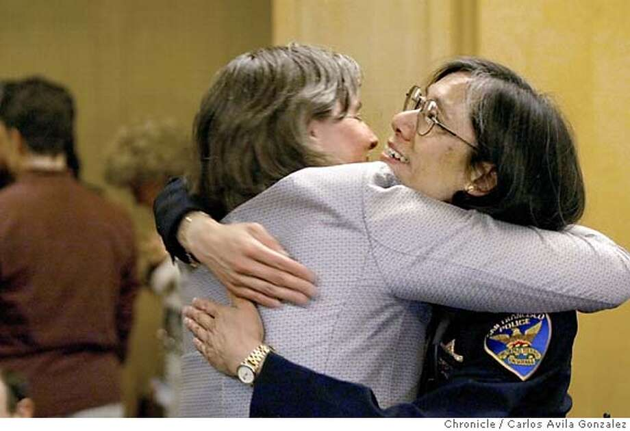 Newly-confirmed San Francisco Chief of Police, Heather Fong, gets a hug from Deputy City Attorney, Margaret Baumgartner, as Fong stopped to thank the public for their support as she was named Police Chief on Wednesday, April 14, 2004. Photo taken on 04/14/04 in San Francisco, Ca. Photo By Carlos Avila Gonzalez / The San Francisco Chronicle Photo: Carlos Avila Gonzalez