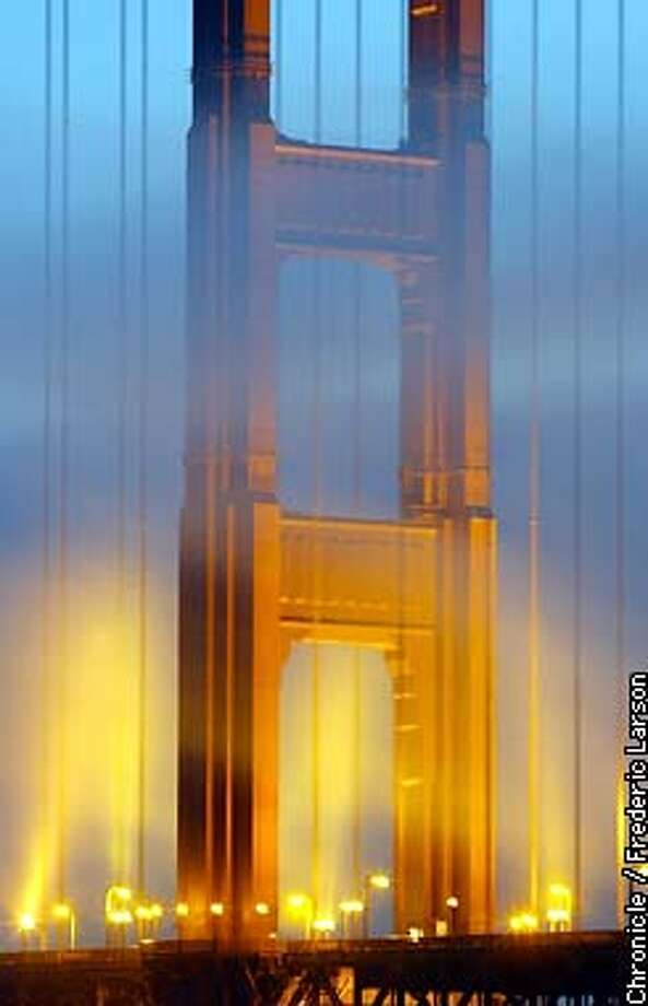 : The cooling fog enter under the GG Bridge in the twlight hours and dance with the lights of the north tower. Chronicle photo by Frederic Larson Photo: Frederic Larson