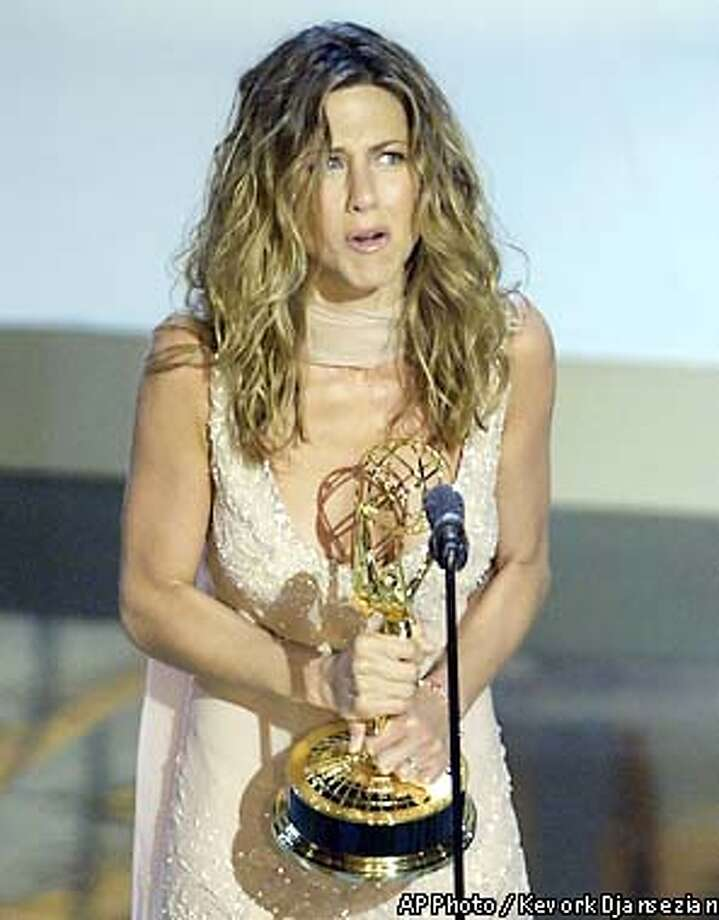 "Jennifer Aniston accepts her award for outstanding lead actress in a comedy series for her work on ""Friends,"" during the 54th Annual Primetime Emmy Awards Sunday, Sept. 22, 2002, at the Shrine Auditorium in Los Angeles. (AP Photo/Kevork Djansezian) Photo: KEVORK DJANSEZIAN"
