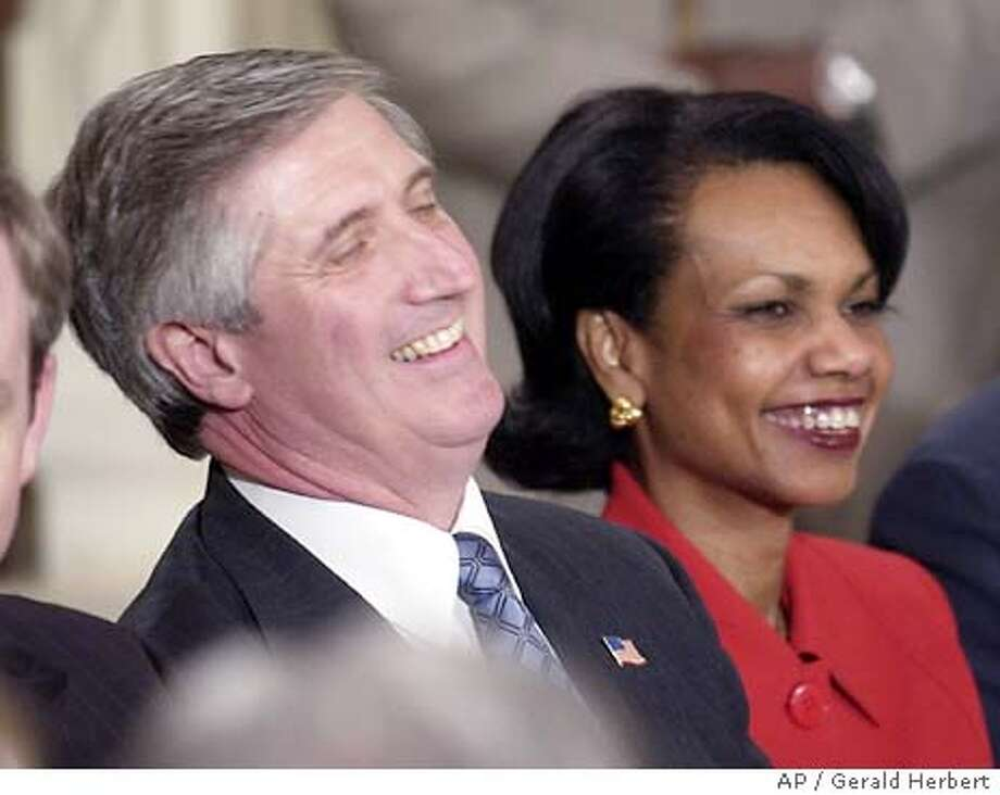 Chief of Staff Andy Card and National Security Adviser Condoleezza Rice share a laugh before the start of a news conference by President Bush in the East Room of the White House Tuesday, April 13, 2004, in Washington. (AP Photo/Gerald Herbert) Photo: GERALD HERBERT