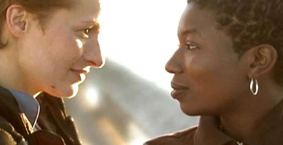 "Brooklyn (Clody Cates, left), a French thief, befriends Robin Hurly (Khahtee V. Turner), an Oakland social worker, in ""Robin's Hood,"" by first-time director Sara Millman, of Oakland. The film is playing at the third annual Black Lesbian, Gay, Bisexual and Transgender Film Festival in San Francisco."