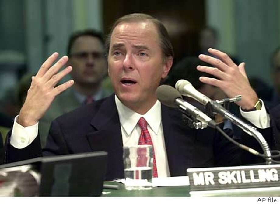 ** FILE ** Former Enron Chief Executive Officer Jeffrey Skilling testifies on Capitol Hill in Washington, in this Feb. 26, 2002, file photo. Skilling, the former Enron Corp. chief executive who resigned less than four months before the company imploded in scandal, was expected to surrender Thursday on charges related to the company's collapse, sources told The Associated Press on Wednesday, Feb. 18, 2004. (AP Photo/Kenneth Lambert, File) Photo: KENNETH LAMBERT