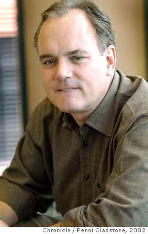 LEVI21B-C-20JUN02-BU-PG Biting his lip as he thi nks of an answer to the writers question. Levi Strauss CEO Phil Marineau chatting about Q2 earnings at his office in Levi Plaza. Chronicle photo by Penni Gladstone ALSO RAN 11/14/2003